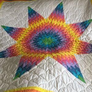 """Starburst Quilt. Rainbow colors. 108"""" x 98""""."""